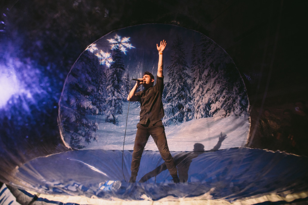 Nathan Quiroga of Iska Dhaaf performs inside a human snow globe at Timbrrr! Winter Music Festival.